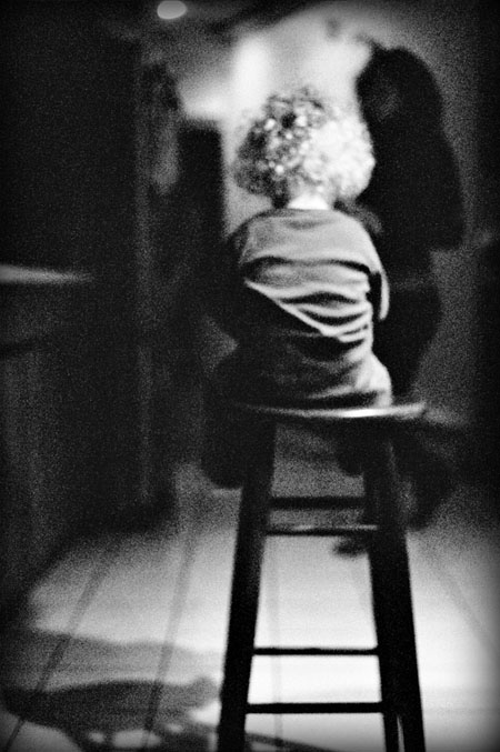 photo of a toddler sitting on a stool