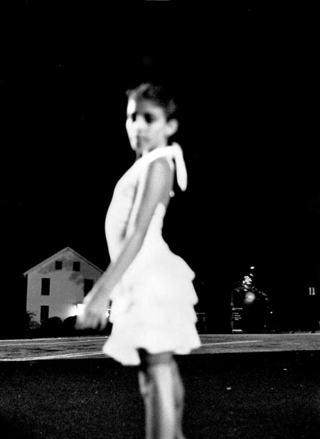soft focus portrait of a young girl at night, fine art portraiture