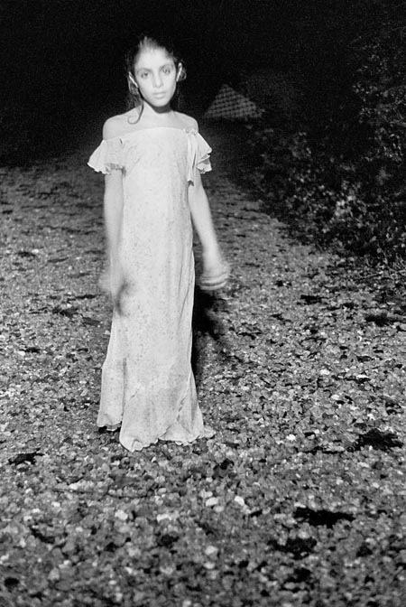 photo of a young girl standing in the road, fine art portraiture