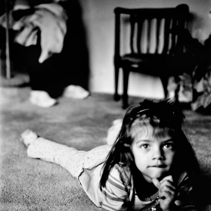 image of a little girl laying on her belly on the floor