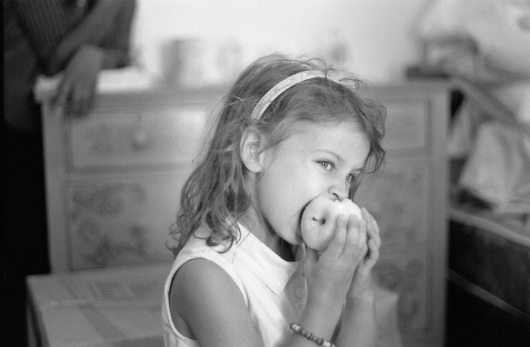 image of a girl biting into an apple.