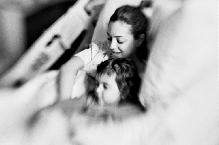 photo of a mom & toddler right after giving birth, fine art portraiture