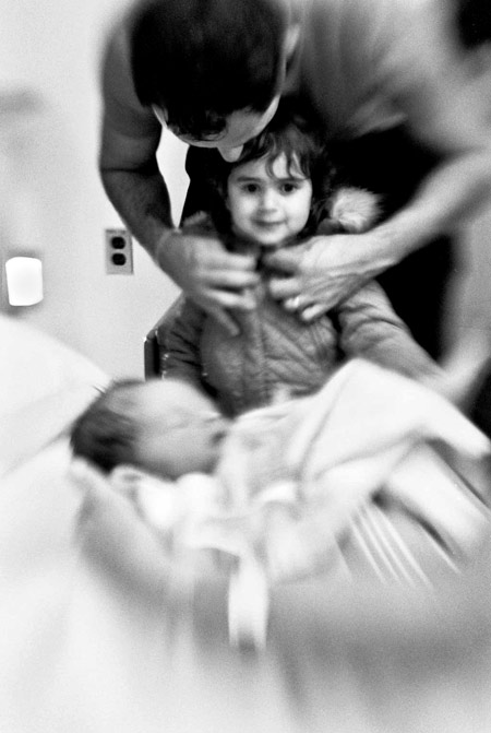 photo of a little girl meeting her newborn baby sister, fine art portraiture