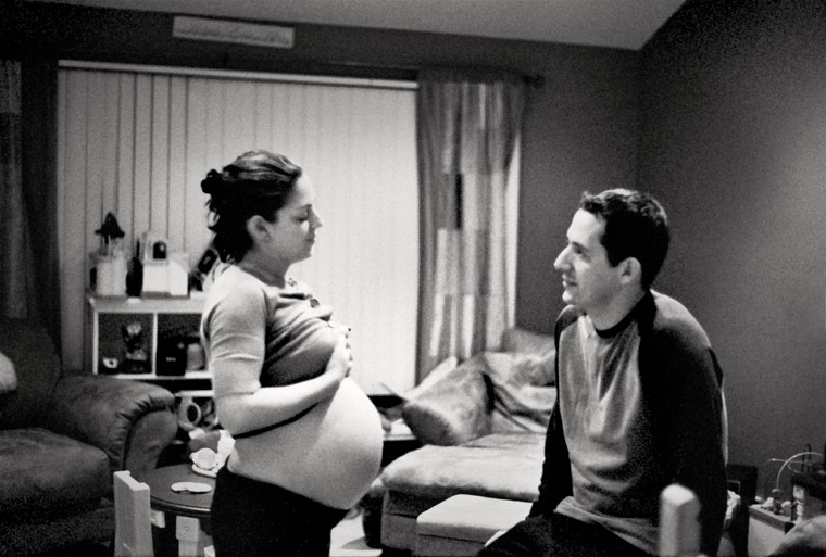 photo of a pregnant woman in labor, fine art portraiture