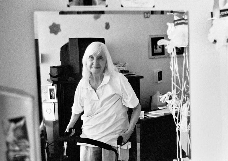photo of an nonagenarian woman using a walker, fine art portraiture