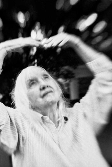 photo of an nonagenarian woman doing tai chi, fine art portraiture