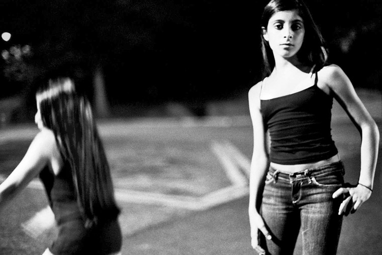 photo of girls dancing in a parking lot, fine art portraiture